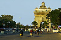Patuxai Arch - Patuxai, literally Victory Gate or Gate of Triumph, formerly the  Anosavari Monument, is a monument in the center of Vientiane.  It is dedicated to those who fought in the struggle for independence from France.  Although bearing a general resemblance to the Arc de Triomphe, in Paris, it is typically Laotian, decorated with many kinnari figures.