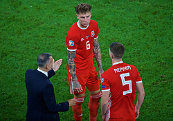 CARDIFF, WALES - Friday, September 6, 2019: Wales manager Ryan Giggs speaks with Joe Rodon and Chris Mepham during the UEFA Euro 2020 Qualifying Group E match between Wales and Azerbaijan at the Cardiff City Stadium. (Pic by Paul Greenwood/Propaganda)