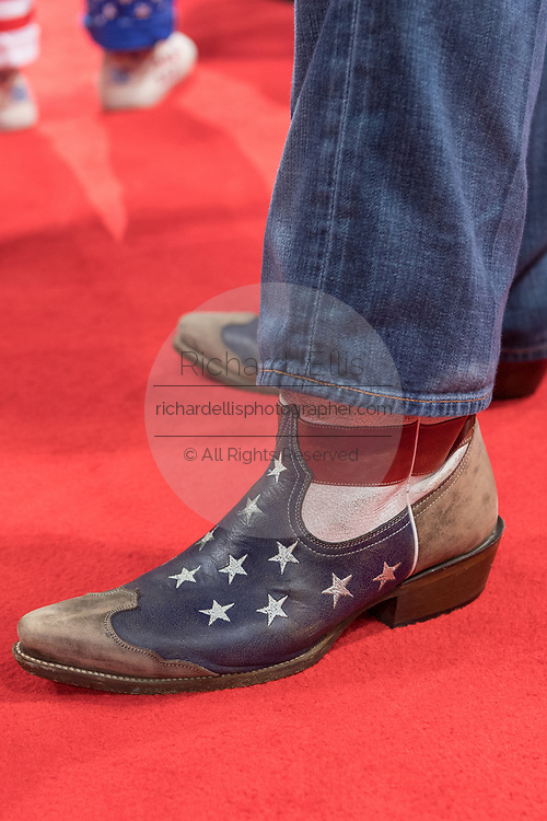 A GOP delegate from Texas wears American flag cowboy boots during the Republican National Convention July 20, 2016 in Cleveland, Ohio.