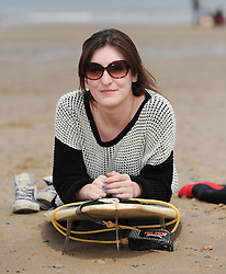 © Licensed to London News Pictures. 27/05/2013..Saltburn, England..Christina Muller from Darlington enjoys the warm bank holiday weather at Saltburn by the Sea in Cleveland....Photo credit : Ian Forsyth/LNP