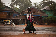Children go home after school while it rains Tanintharyi Region, Burma.<br />