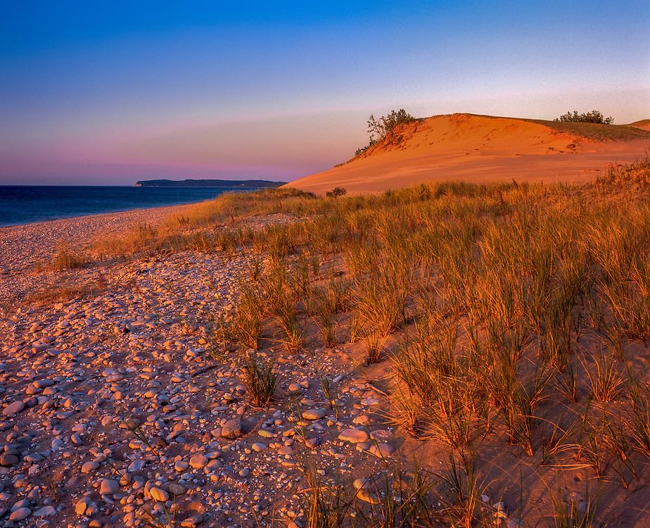 Dunes, beach stones & Lake Michigan, strong pink light, summer, Sleeping Bear Dunes National Park, MI