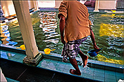 An Indian Muslim washes his feet in a ritual of ablution before prayers at the Kapitan Kling Mosque in Penang. A minority that constitutes about 7 percent of Malaysia's population, most Indians most are descendants of Indians who migrated from India during the British colonization of tin-and-rubber-rich Malaya. <br /> © Steve Raymer 2002 / ALL RIGHTS RESERVED