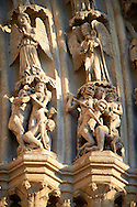 Tympanum of central west portal: Scenes of the Damned in Hell Last  Day of Judgement, supported by an array of saints.  Gothic Cathedral of Notre-Dame, Amiens, France . The Cathedral Basilica of Our Lady of Amiens or simply Amiens Cathedral, is a Roman Catholic  cathedral the seat of the Bishop of Amiens. It is situated on a slight ridge overlooking the River Somme in Amiens. Amiens Cathedral, was built almost entirely between 1220 and c.1270, a remarkably short period of time for a Gothic cathedral, giving it an unusual unity of style. Amiens is a classic example of the High Gothic style of Gothic architecture. It also has some features of the later Rayonnant style in the enlarged high windows of the choir, added in the mid-1250s. Amiens Cathedra has been listed as a UNESCO World Heritage Site since 1981. Photos can be downloaded as Royalty Free photos or bought as photo art prints. <br /> <br /> Visit our MEDIEVAL PHOTO COLLECTIONS for more   photos  to download or buy as prints https://funkystock.photoshelter.com/gallery-collection/Medieval-Middle-Ages-Historic-Places-Arcaeological-Sites-Pictures-Images-of/C0000B5ZA54_WD0s