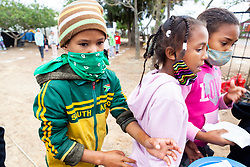 """Young children collect their food parcels at a """"Safe Zone"""" in Vanwyk'svlei, Wellington, Western Cape, South Africa.(Picture: JULIAN GOLDSWAIN)"""
