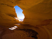 "Sandstone Window near Melody Arch, in the vicinity of North Coyote Buttes area known as ""The Wave,"" Vermillion Cliffs National Monument, Arizona, known for its beautiful rock formations."