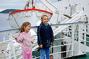 Two children (5 years old, 9 years old) on inter-island ferry, en-route to Dubrovnik, Croatia
