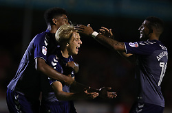Charlton Athletic's George Lapsie (centre) celebrates scoring his side's second goal of the game