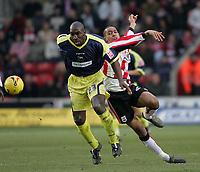 Photo: Lee Earle.<br /> Southampton v Derby County. Coca Cola Championship. 04/02/2006. Derby's Darren Moore (L) battles with Dexter Blackstock.