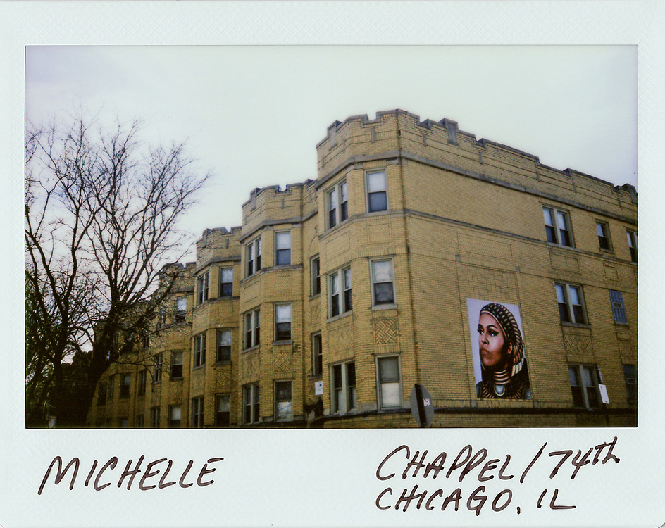 A portrait of former U.S. fist lady Michelle Obama is painted on the side of a building in Chicago. Photograph taken using a Fujifilm Instax wide instant film camera.