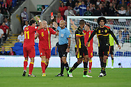James Collins of Wales (5) is sent off after a tackle on Belgium's Guillaume Gillet. World cup 2014 qualifying match, Group A, Wales v Belgium at the Cardiff city stadium in Cardiff, South Wales on Friday 7th Sept 2012.  pic by  Andrew Orchard, Andrew Orchard sports photography,