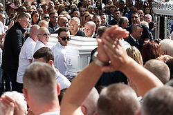 © Licensed to London News Pictures . Salford , UK . File picture of JOHN KINSELLA (behind coffin with cropped grey hair and glasses) carrying Paul Massey's coffin at Paul Massey's funeral , in Salford , on 28th May 2015. Police have arrested several men in connection with the murders of both Kinsella and Massey. Photo credit : Joel Goodman/LNP
