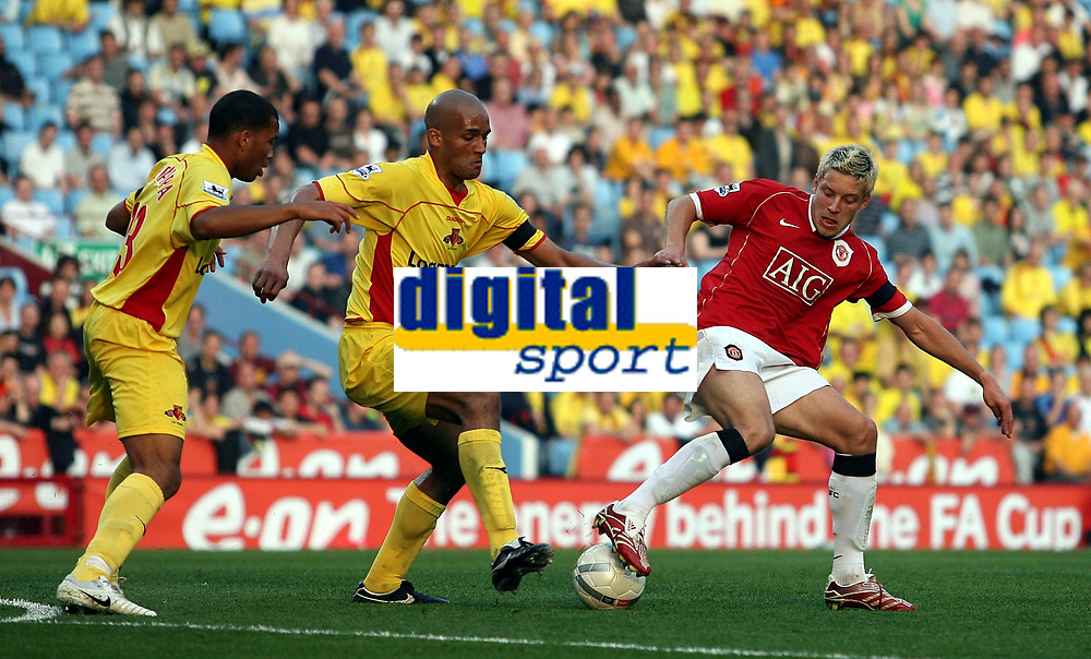 Photo: Paul Thomas.<br /> Watford v Manchester United. The FA Cup, Semi Final. 14/04/2007.<br /> <br /> Alan Smith (R) of Utd keeps the ball away from Clarke Carlisle.