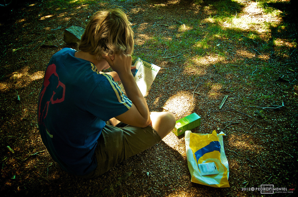 Highliner Flo Herla studying the antidote instruction manual that would eliminate his Nits problem.  New Zealand.