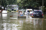 Torrential rains flooded parts of South Bend and closed many streets on Tuesday August 16, 2016. The Crest Manor neighborhood on the south end of town was particularly hard hit.  Many home sustained water damage.  Aaron Nowak rows a boat down Danbury Dr.
