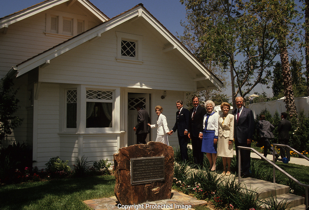 Presidents Reagan, Bush 41, and Ford pose at the birthplace of Richard Nixon at the opening of the Nixon Presidential Library on July 19, 1990..Photograph by Dennis Brack bb24