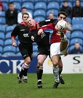 Photo. Andrew Unwin.<br /> Burnley v Rotherham, Coca-Cola Championship, Turf Moor, Burnley 12/03/2005.<br /> Rotherham's Michael Keane (L) looks to challenge Burnley's Jean Louis Valois (R).
