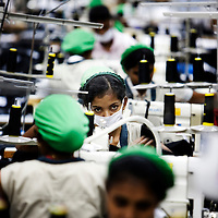 Machine operators at work in a garment factory in Colombo Sri Lanka...Garments are one of Sri Lanka's  biggest exports. The Garment industry  manufactures garments for popular world brands. Yet the machine operators are underpaid and face social stigma due to the long and un-social hours they are made to work, which prevents them from getting married and starting a family - a significant social more in Sri Lankan culture.Gv's of 44 Stevenson Drive..Picture Michael Hughes. 25/10/08.