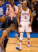 June 2, 2012; Oklahoma City, OK, USA; Oklahoma City Thunder guard Russell Westbrook (0) reacts to a play during the second half of a playoff game against the San Antonio Spurs at Chesapeake Energy Arena.  Thunder defeated the Spurs 109-103 Mandatory Credit: Beth Hall-US PRESSWIRE