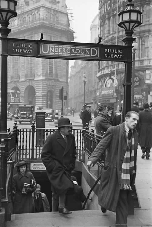 People Exiting Piccadilly Underground Station, London, England, c. 1939