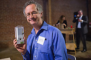 Steven Colby of Peters Verny, LLP., poses with a hand crank battery he won during a raffle during the Silicon Valley Business Journal's HHaaS Tech Mixer at ZERO1 in San Jose, California, on May 28, 2015. (Stan Olszewski/SOSKIphoto for the Silicon Valley Business Journal)