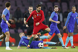 (L-R) Donny van de Beek of Holland, Andre Gomes of Portugal during the International friendly match match between Portugal and The Netherlands at Stade de Genève on March 26, 2018 in Geneva, Switzerland