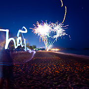 Girl lightpaints the word Thai, Phuket, Thailand