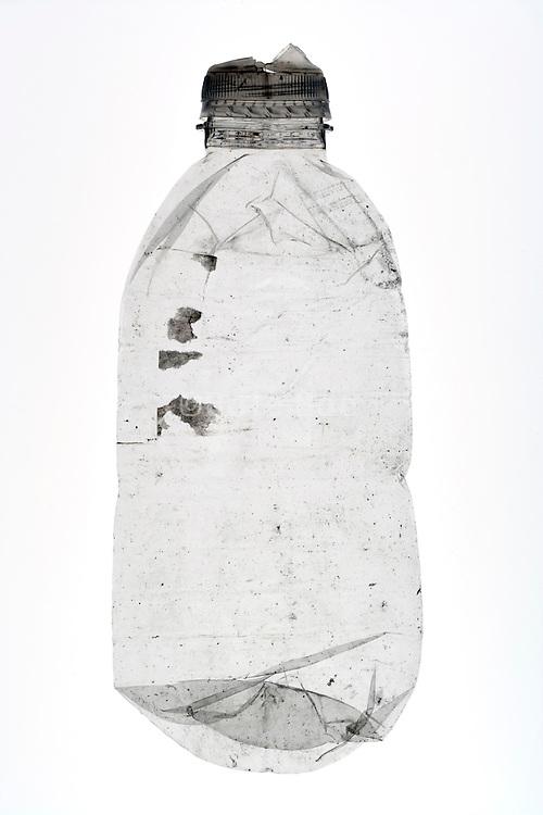 flattened small plastic water bottle