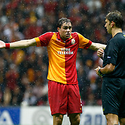 Galatasaray's  Johan Elmander and Referee's Paolo Tagliavento during their UEFA Champions League Group H matchday 3 soccer match Galatasaray between CFR Cluj at the TT Arena Ali Sami Yen Spor Kompleksi in Istanbul, Turkey on Tuesday 23 October 2012. Photo by Aykut AKICI/TURKPIX