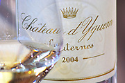 glass and bottle of 2004 chateau d'yquem sauternes bordeaux france
