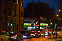 © Licensed to London News Pictures.  01/10/2021. London, UK. Motorists line up in the street in front of the petrol station in Vauxhall, central London; in the early morning. As the eighth day of the fuel crisis continues, amid fears of petrol running out due to a shortage of HGV drivers.  Photo credit: Marcin Nowak/LNP
