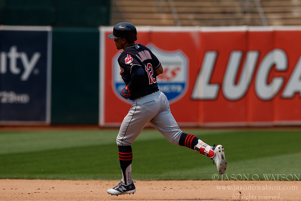 OAKLAND, CA - JULY 01: Francisco Lindor #12 of the Cleveland Indians rounds the bases after hitting a home run against the Oakland Athletics during the seventh inning at the Oakland Coliseum on July 1, 2018 in Oakland, California. The Cleveland Indians defeated the Oakland Athletics 15-3. (Photo by Jason O. Watson/Getty Images) *** Local Caption *** Francisco Lindor
