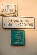 Sign of the Route Napoleon on facade in the beach town, Avenue de La Gare, Golfe-Juan, France.