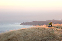 Young man biking near Bolinas Ridge; Mt. Tamalpais State Park. Golden Gate National Recreation Area. San Francisco,  CA<br />