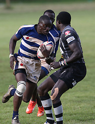 Isaac Mwaura (C) of Mean Machine in action against Colins Injera of Mwamba RFU during their Kenya Cup Tournament at Railway Club In Nairobi, on 3rd December 2016. Mwamba won 51-8. Photo/Fredrick Onyango/www.pic-centre.com (KEN)