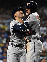 October 25, 2017 - Los Angeles, California, U.S. - Houston Astros' George Springer, right celebrates with teammate Jose Altuve after hitting a two run home run to break 5-5 tie against the Los Angeles Dodgers in the eleventh inning of game two of a World Series baseball game at Dodger Stadium on Wednesday, Oct. 25, 2017 in Los Angeles. Houston Astros won 7-6 in 11 innings. (Photo by Keith Birmingham, Pasadena Star-News/SCNG) (Credit Image: © San Gabriel Valley Tribune via ZUMA Wire)