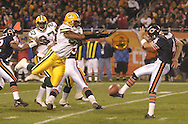 Packers Marcus Wilkins blocks a punt by Bears Brad Maynard, during the Monday Night Football game reopening Solider Field after having been closed for a renovations.  This was the third blocked punt the Bears gave up that year after going 8 years without a block...ASSIGNMENT DETAILS: Bears host Packers Monday Night football for the reopening of soldiers field .WHERE: .NUMBER OF PHOTOS NEEDED:  Several of course.DATE DUE: Whenever Josh wants.ASSIGNED BY: Lydia, though Josh's constant harassment was the real source..MISC. INFO: Packers Marcus Wilkins blocks a punt by Bears Brad Maynard, after going something like 8 years without a block they've given up 3 this year, they suck, can you do me a favor?  Tell Haydn they suck also..KEYWORDS: sports.PHOTO BY: Josh Hawkins.DIGITAL NUMBER: 4511.FILE NAME: Oct2_03/cj/soldiers5