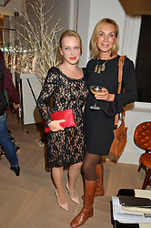 Left to right, Maria Dormidontova and Lilia Scheffler-Sennowa at a private view of Stephen Webster's new White Kite collection held at his flagship store at 130 Mount Street, London on 24th November 2016.