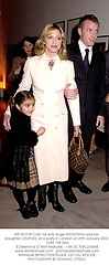 MR GUY RITCHIE, his wife singer MADONNA and her daughter LOURDES, at a party in London on 29th January 2002.                                      OWZ 149 3olo