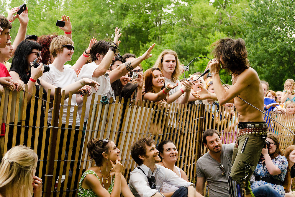 Eugene Hütz of Gogol Bordello, off-stage, working the crowd along fence at The Appel Farm's 2011 Arts & Music Festival in Elmer, NJ.