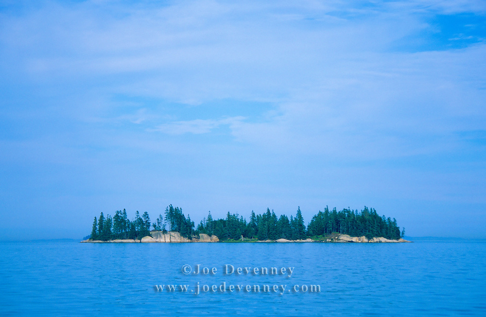 A tree covered small island in Penobscot Bay. Gulf of Maine off Stonington, Maine