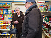 "25 FEBRUARY 2020 - BUTTERFIELD, MINNESOTA: MARY SCHULTE and KERMIT LEET, both from Butterfield, chat at the True Value Hardware Store in Butterfield, MN, a farming community of about 500 people 130 miles southwest of the Twin Cities. The town has been a ""food desert"" for 10 years after its only grocery store closed in 2010. Barb Mathistad Warner and Mark Warner purchased the True Value store in Butterfield in December, 2018 and started selling groceries in the store in May, 2019. For residents of Butterfield going to a grocery store meant driving 10 miles to St. James, MN, or 20 miles to Windom, MN, the two nearest communities with grocery stores. The USDA defines rural food deserts as having at least 500 people in a census tract living 10 miles from a large grocery store or supermarket. There is a convenience store in Butterfield, but it sells mostly heavily processed, unhealthy snack foods that are high in fat, sugar, and salt.    PHOTO BY JACK KURTZ"