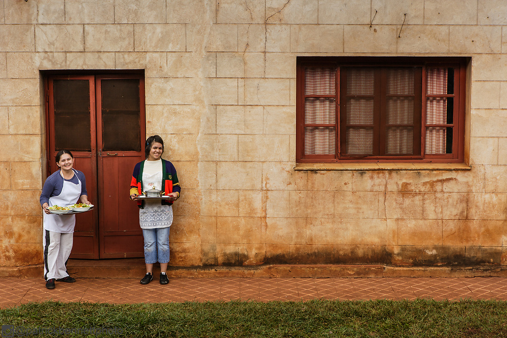 The maids with lunch outside of the kitchen house at the estancia Santa Inés near Posadas, Argentina.