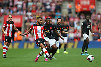 Football - 2019 / 2020 Premier League - Southampton vs. Manchester United<br /> <br /> Southampton's Sofiane Boufal under pressure from Aaron Wan-Bissaka of Manchester United during the Premier League match at St Mary's Stadium Southampton <br /> <br /> COLORSPORT/SHAUN BOGGUST