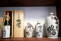 """Sake Bottles - Sake is a Japanese alcoholic beverage made from rice. In Japanese, sake refers to alcoholic drinks in general. The Japanese term for this specific drink is Nihonshu, meaning """"Japanese sake.""""<br /> Sake is also referred to in English as rice wine. However, unlike true wine, in which alcohol is produced by fermenting the sugar naturally present in fruit, sake is made through a brewing process more like that of beer."""