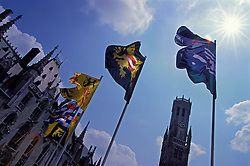 "BRUGES, BELGIUM - The sun shines on the ""Markt"", the town square of Bruges, where Flemish and regional flags fly in the breeze above the town hall and Belfry clock tower. Bruges is an ancient city steeped in 2000 years of history and was once called ""Venice of the North"" for it's similar network of interconnecting canals.(Photo © Jock Fistick)"