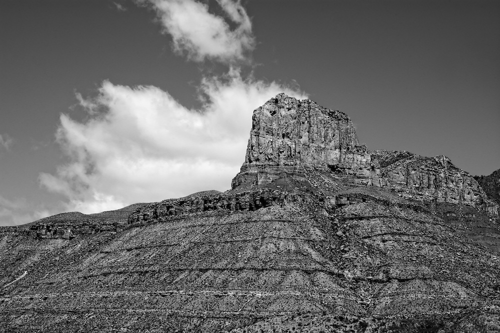 El Capitan in West Texas' Guadalupe Mountains (100 miles east of El Paso) is the world's premier example of an exposed fossil reef from the Permian Era, dated at about 260 million years old - much older than the golden age of dinosaurs. This whole part of Texas back in this time was once covered in a shallow sea that geologists call the Delaware Sea, in a time when all of Earth's continents were still joined into one supercontinent that we call Pangaea. The entire top of El Capitan is made of limestone formed from the fossilized remains of aquatic plant and animal remains such as corals, algae, shellfish and plankton, and now stands at just above 8000 feet above sea level. The base is formed by layer upon layer of sand laid down over millions of years, in the manner you would expect from the ocean floor resulting in a very typical sedimentary rock formation,  further eroded by millions of years of desert heat, rain, abrasion and wind.