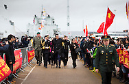 China's ambassador to the UK, Liu Xiaoming, waves to members of the British Chinese community waiting to board the Chinese Naval assault ship Chang Bai Shan at Portsmouth Royal Navy Base today. The ship is involved in the first visit by the Chinese Navy to the UK since 2007 and the largest ever. She is accompanied by the frigate Yun Cheng and the replenishment ship Chaohu. The ships arrived in Portsmouth 24 hours early due to the expected bad weather. The Royal Navy statement stated that the five day formal visit is aimed at enhancing military understanding between the UK and China. Picture date Monday 12th January, 2015.<br /> Picture by Christopher Ison. Contact +447544 044177 chris@christopherison.com