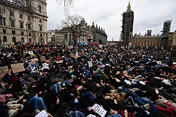 © Licensed to London News Pictures. 14/03/2021. London, UK. Protestors embrace outside Parliament in London for a demonstration, organised by Sisters Uncut, against the actions of the police force at a vigil for murdered Sarah Everard yesterday evening. There have been calls for Met Chief Cressida Dick to resign following yesterday's scenes, when police dragged women away from a bandstand as thousands gathered in Clapham, South London. Photo credit: Ben Cawthra/LNP