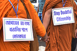 August 1, 2018 - Kolkata, West Bengal, India - Social activist hold poster and make human chain to protest against Assam National Register of Citizen or NRC final draft. (Credit Image: © Saikat Paul/Pacific Press via ZUMA Wire)